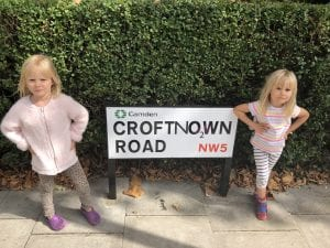 Picture of 2 young girls standing by road sign saying Croftno2wn Road